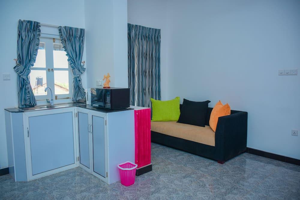 Апартаменты базового типа, 2 спальни, вид на океан - Зона гостиной