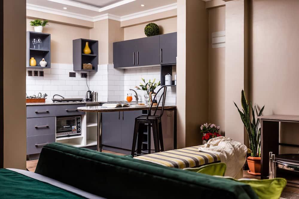 精緻開放式套房 - 客房內用餐