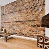 Luksusa mansarda numurs - Dzīvojamā istaba