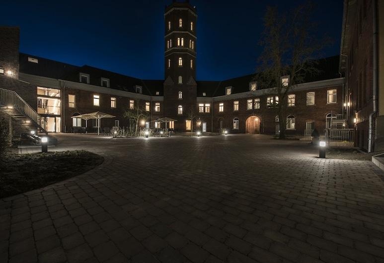 Alexianer Hotel am Wasserturm, Münster/Munster, Fachada del hotel de noche