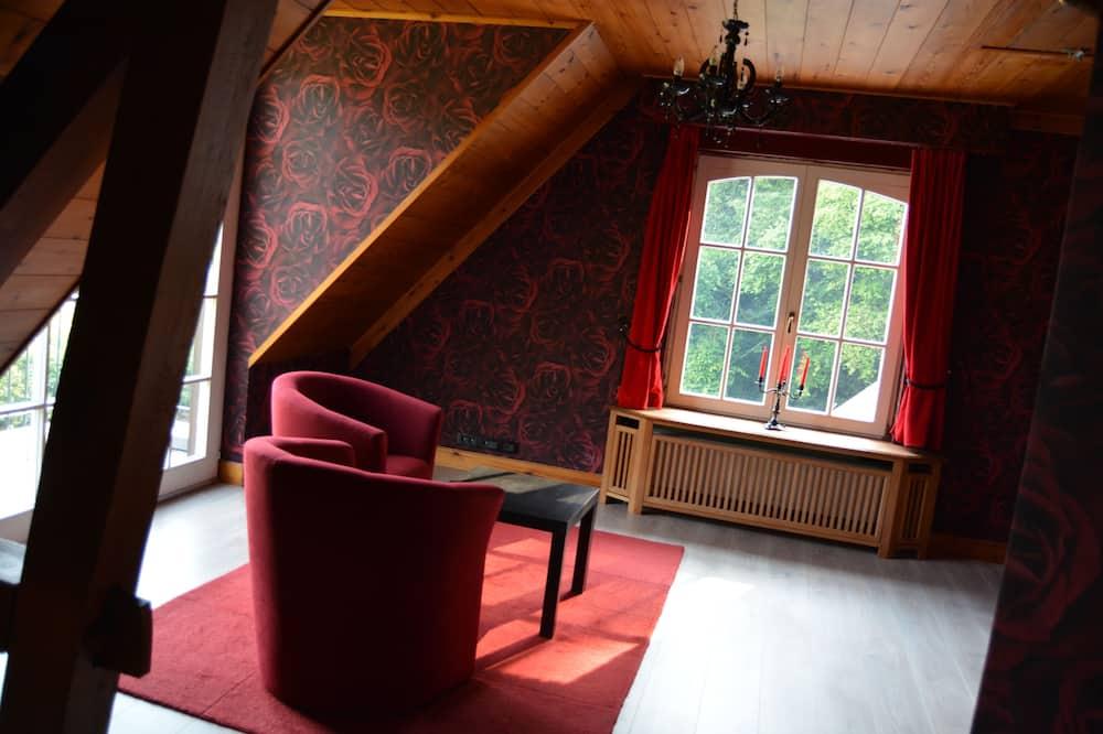 Deluxe Room, Balcony - Living Area