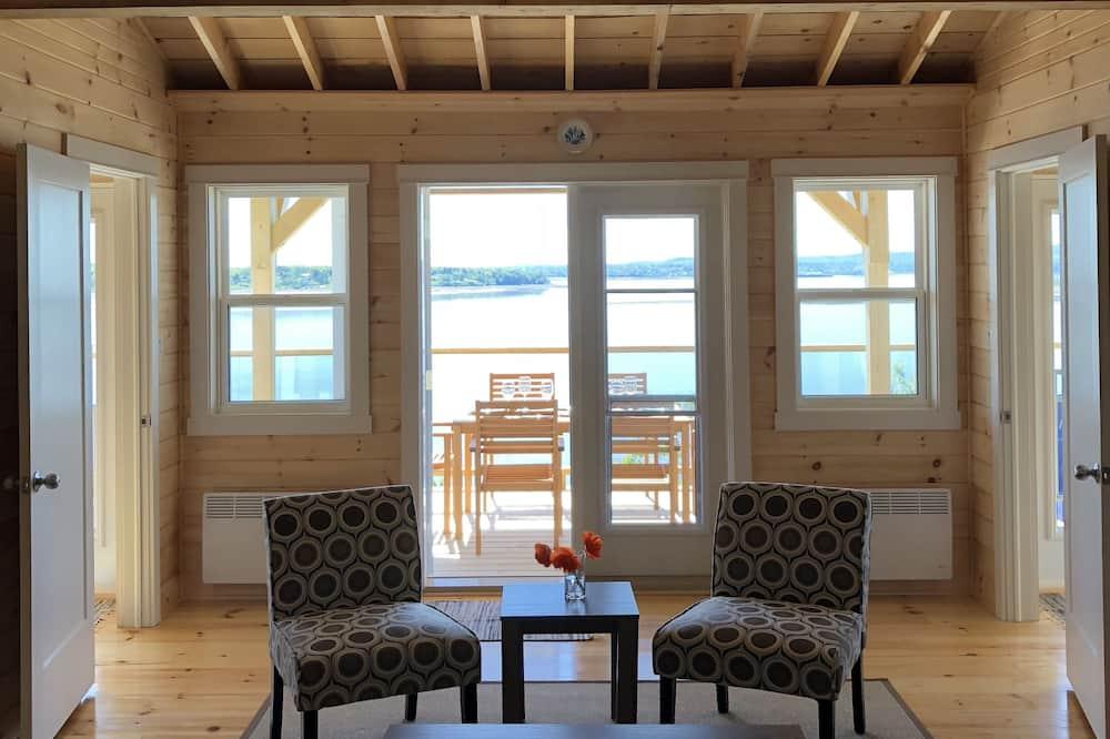 Panorāmas kotedža, divas guļamistabas, skats uz okeānu, pretī okeānam - Dzīvojamā zona