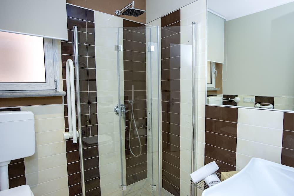 Tuba, 2 magamistoaga, kööginurgaga, asub esimesel korrusel - Vannituba