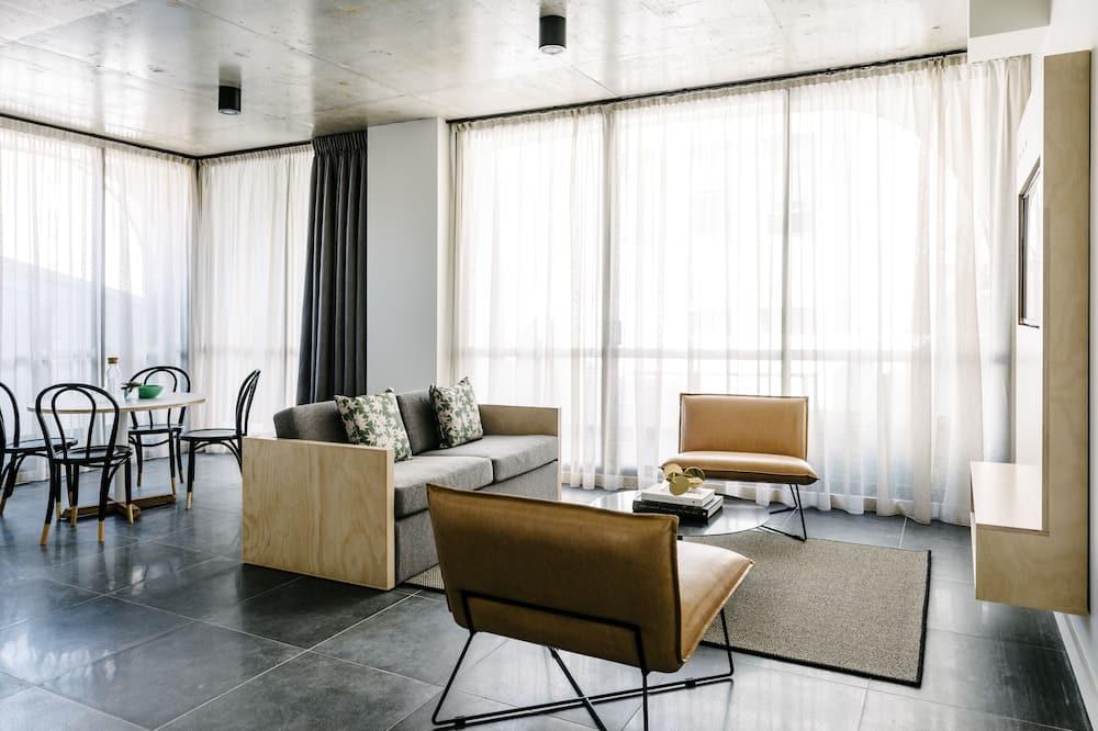 Deluxe One Bedroom Suite - Wohnbereich