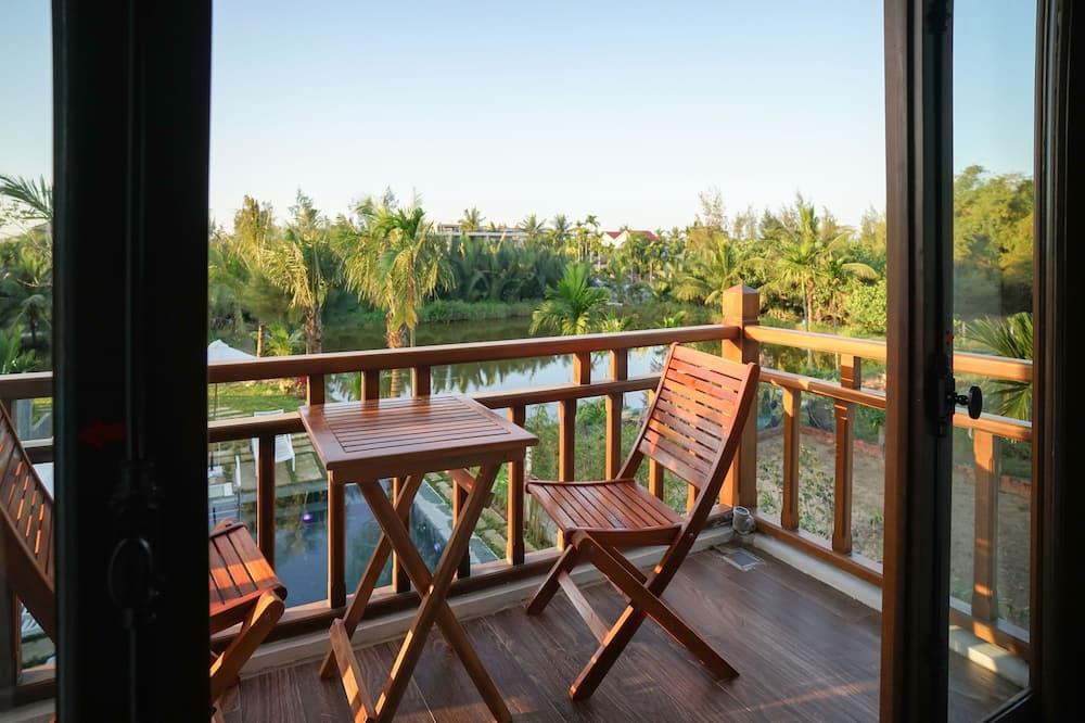 Deluxe Tek Büyük Yataklı Oda, Bahçe Manzaralı - Balkon