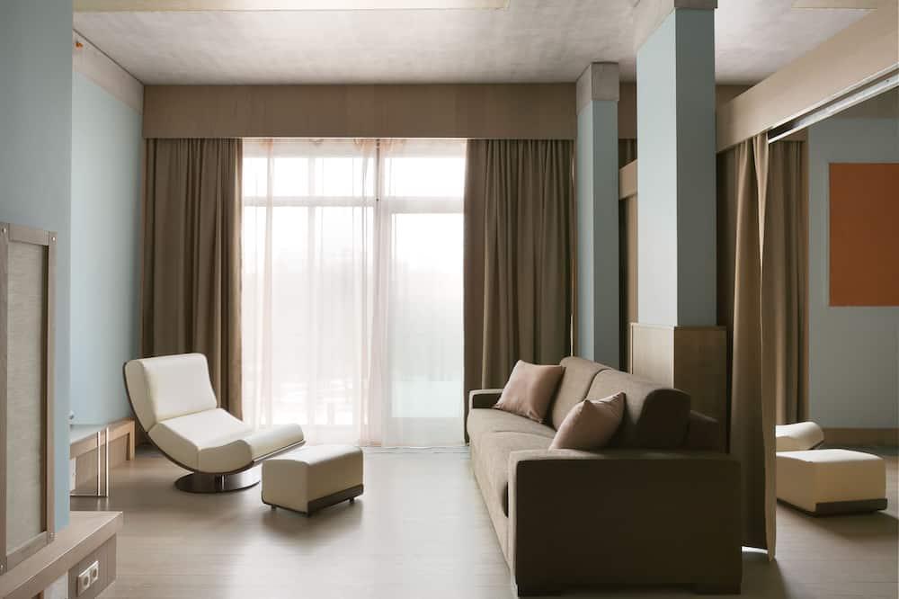 เอ็กเซกคิวทีฟอพาร์ทเมนท์, 1 ห้องนอน, ห้องครัว, วิวสวน - ห้องนั่งเล่น