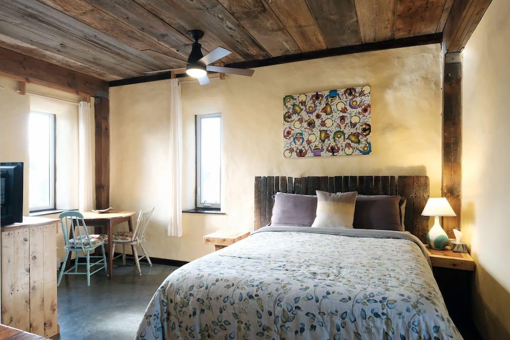 Studiosuite, 1 queensize-seng, tekjøkken, utsikt mot hage (B) - Oppholdsområde