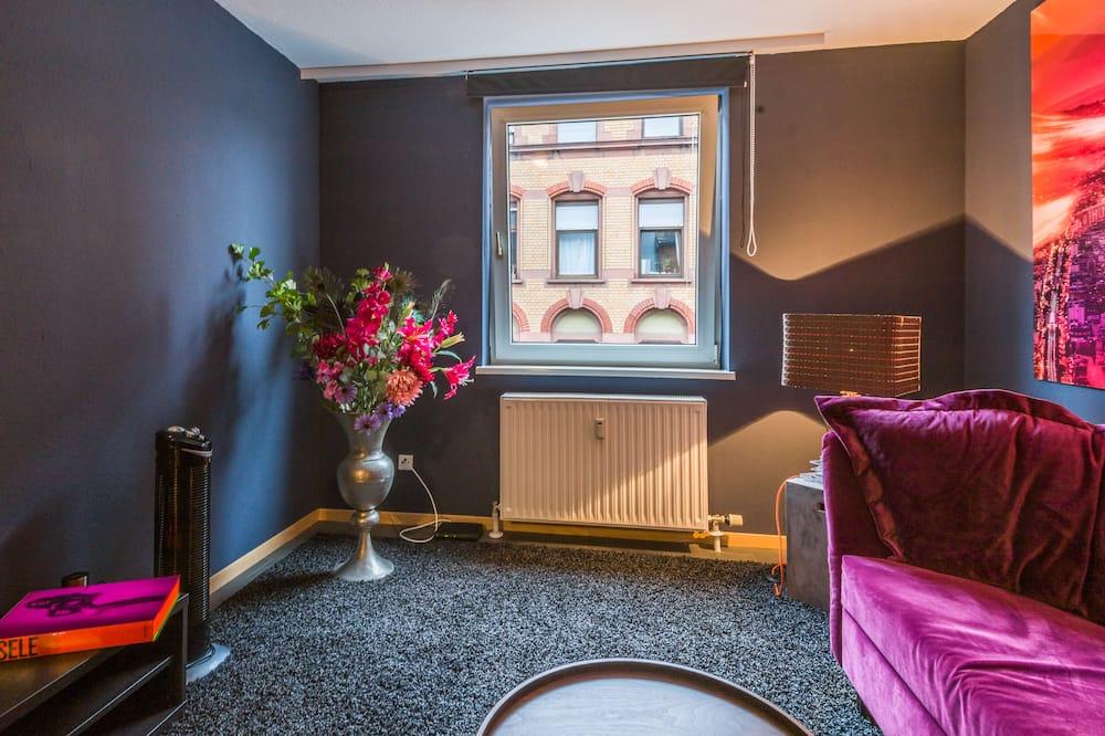 Departamento de lujo, 1 habitación, cocina básica, vista a la ciudad - Sala de estar
