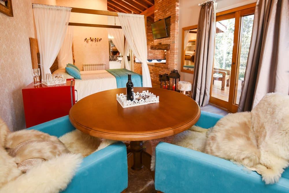 בקתת פרימיום, אמבט זרמים - אזור אוכל בחדר