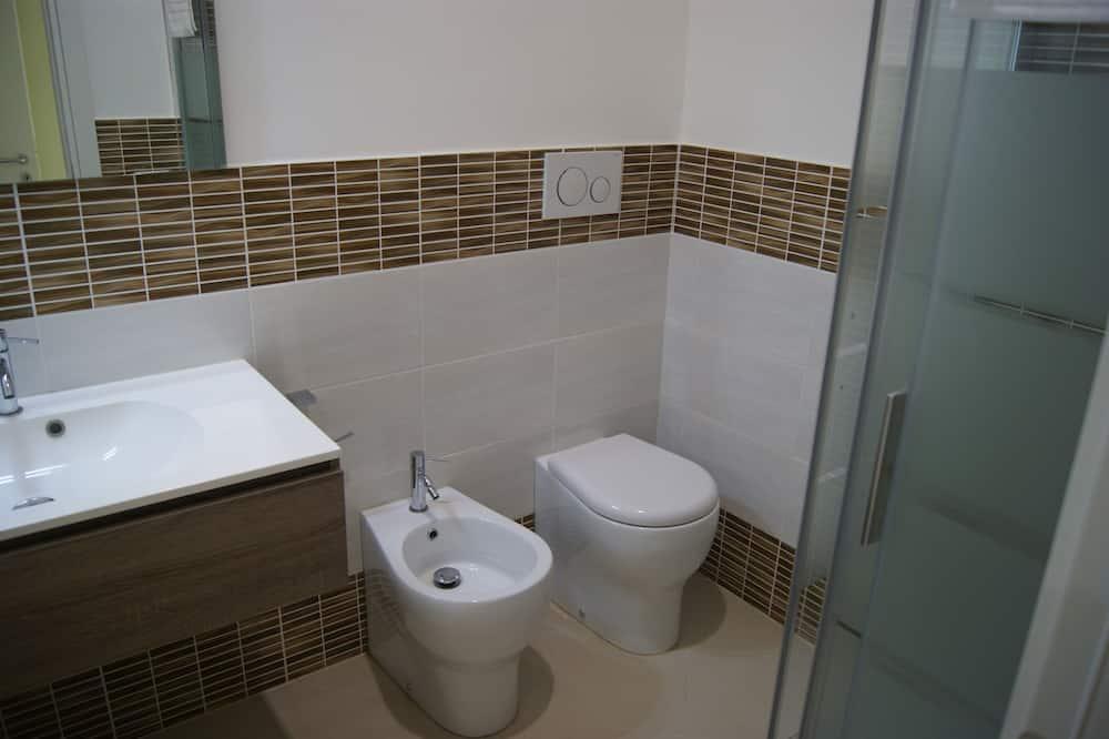 Phòng đơn cơ bản, Tầng trệt - Phòng tắm