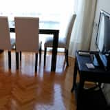 อพาร์ทเมนท์, 1 ห้องนอน, ห้องครัว - พื้นที่นั่งเล่น