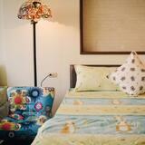 Comfort Quadruple Room - Living Room