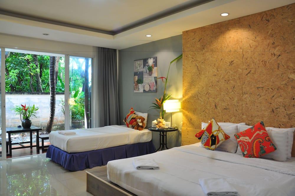Family Triple Room, 2 Bedrooms, Garden View, Garden Area - Bilik Tamu