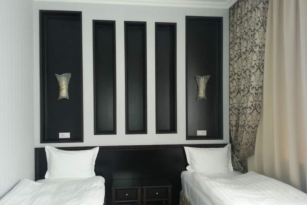 Habitación estándar con 1 cama doble o 2 individuales - Habitación