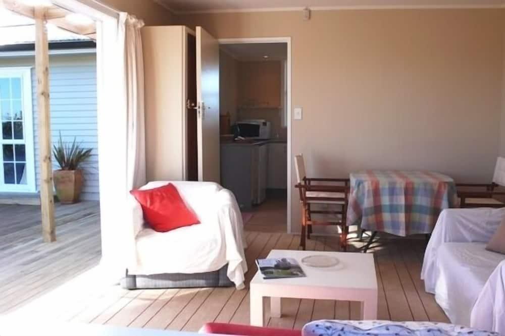 Rekreačná chata typu Deluxe, výhľad na záhradu - Obývačka