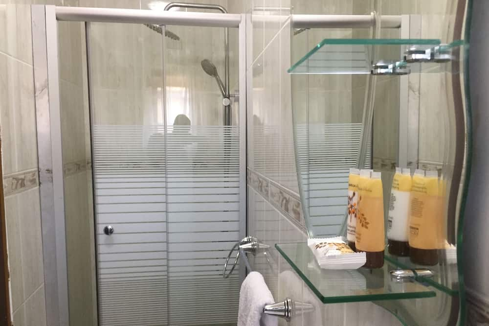 Представительский номер, вид на сад - Ванная комната