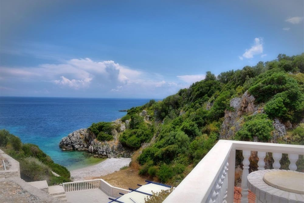 Romantisks studijas tipa numurs, skats uz jūru (A) - Skats uz pludmali/okeānu
