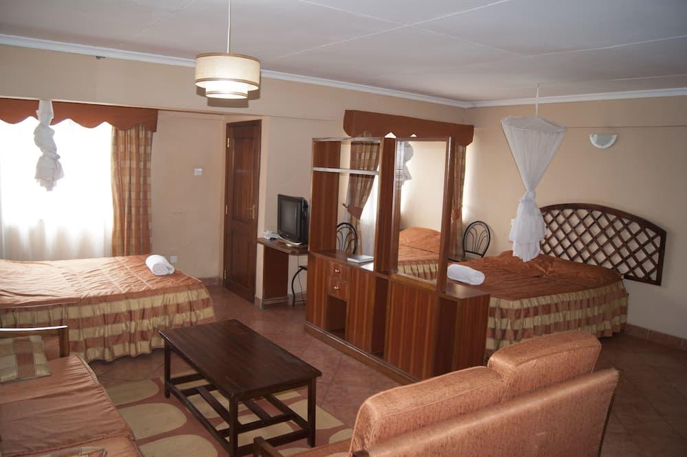 Familien-Doppelzimmer, 2Queen-Betten, Stadtblick, Eckzimmer - Wohnbereich