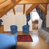 Standard Quad Room - Living Area