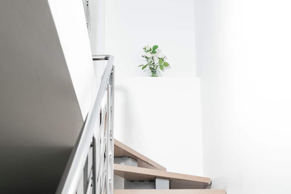 Suite familiar, vista a la ciudad - Sala de estar