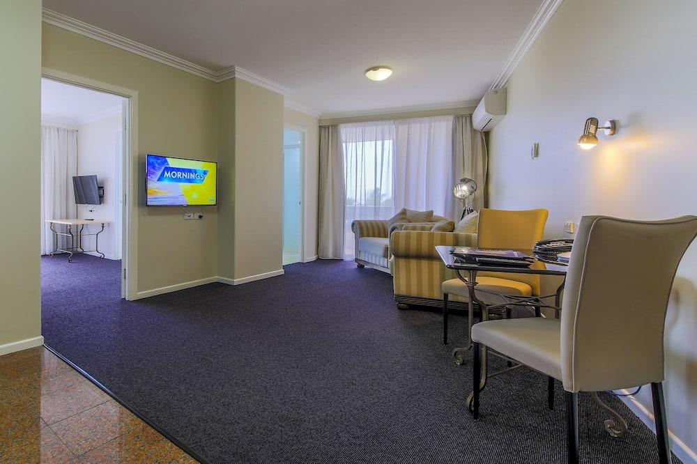 Suite Deluxe, 1 letto king, idromassaggio - Area soggiorno