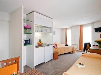 Introduce las fechas para ver los descuentos de hoteles en Courbevoie