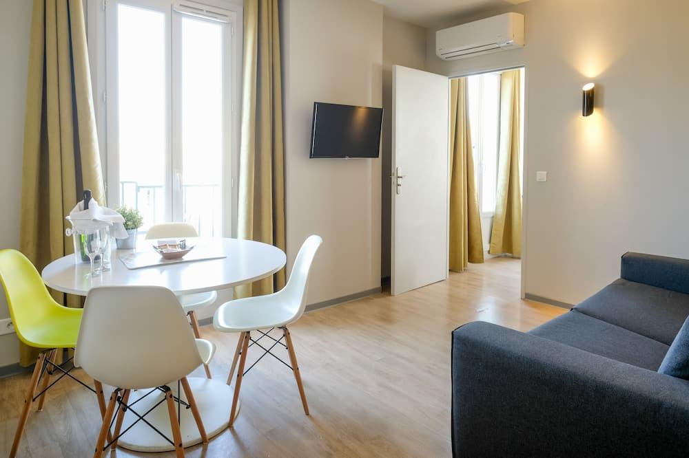 Departamento Confort, balcón - Sala de estar