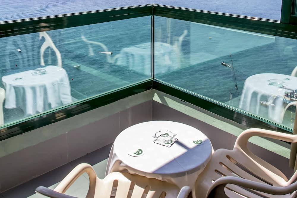 Tremannsrom, balkong, utsikt mot sjø - Utsikt mot strand/hav