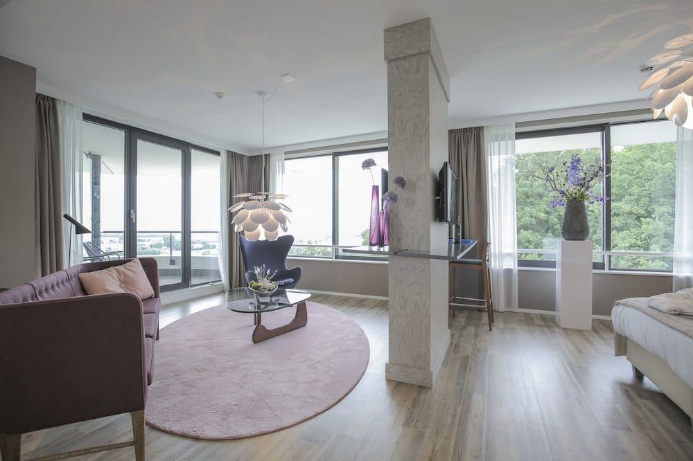 Deluxe-Suite, Balkon, Flussblick - Wohnbereich