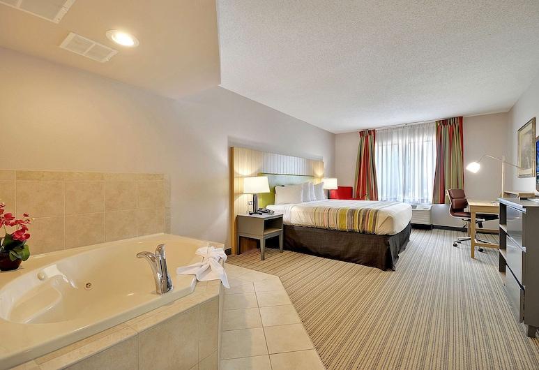 Country Inn & Suites by Radisson, Charleston North, SC, North Charleston, Suite, 1 King Bed, Non Smoking, Jetted Tub, Guest Room