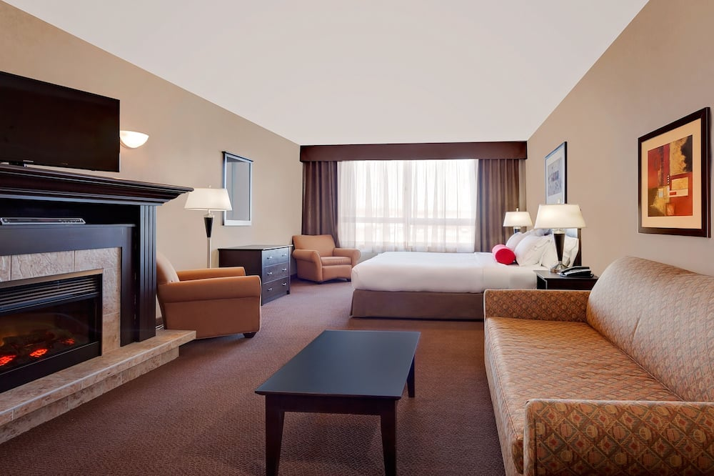 Suite, 1 King Bed, Non Smoking, Fireplace (with Sofabed) - Living Area