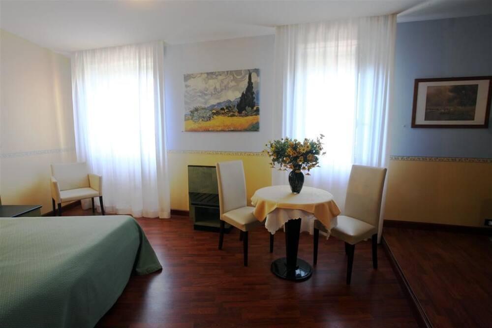 Čtyřlůžkový pokoj - Obývací prostor