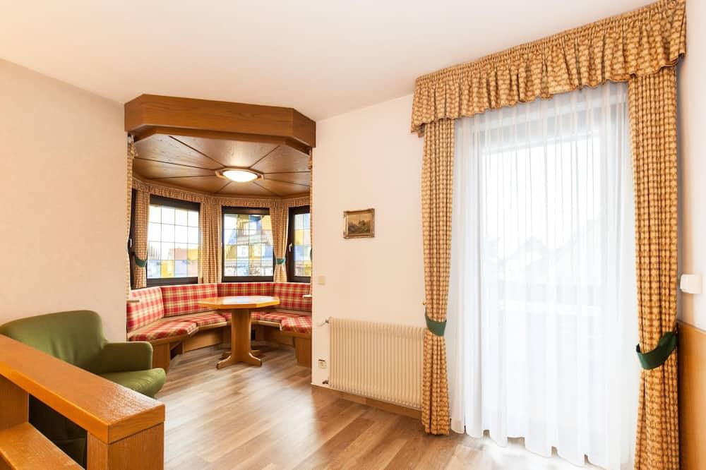 Comfort Plus Zimmer A - Wohnbereich