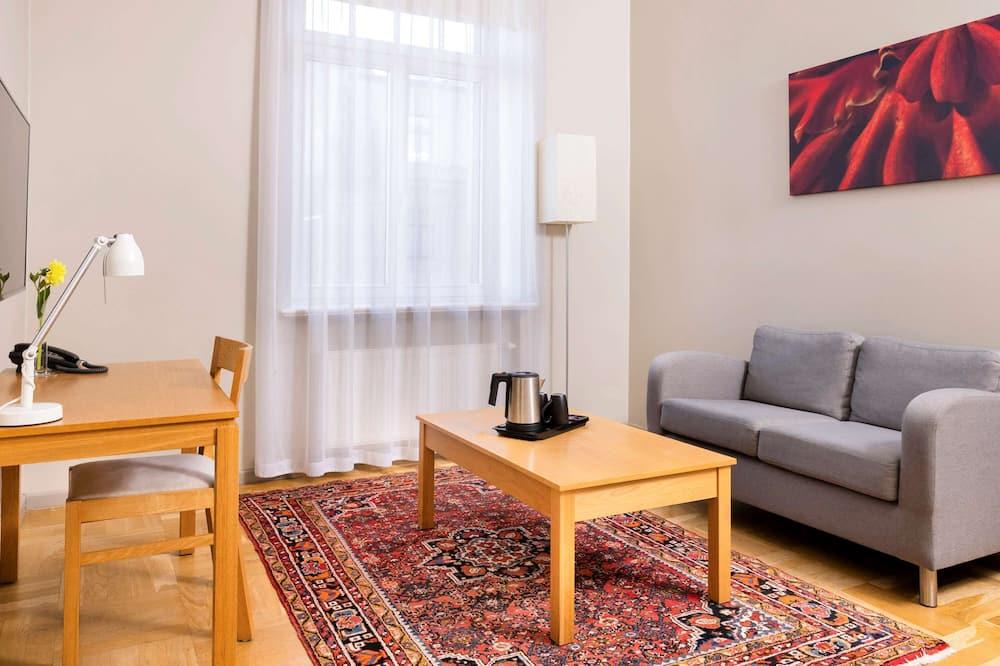 Pokoj Executive s dvojlůžkem, dvojlůžko a rozkládací pohovka - Obývací pokoj