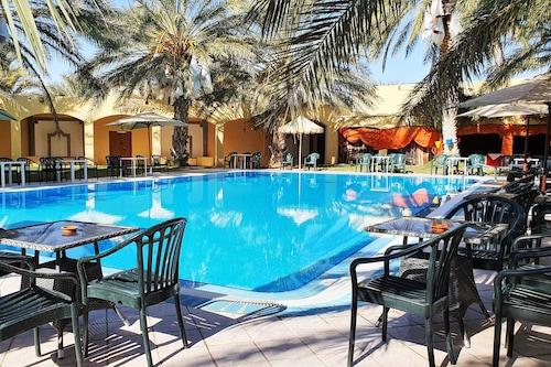 杜茲太陽棕櫚飯店/
