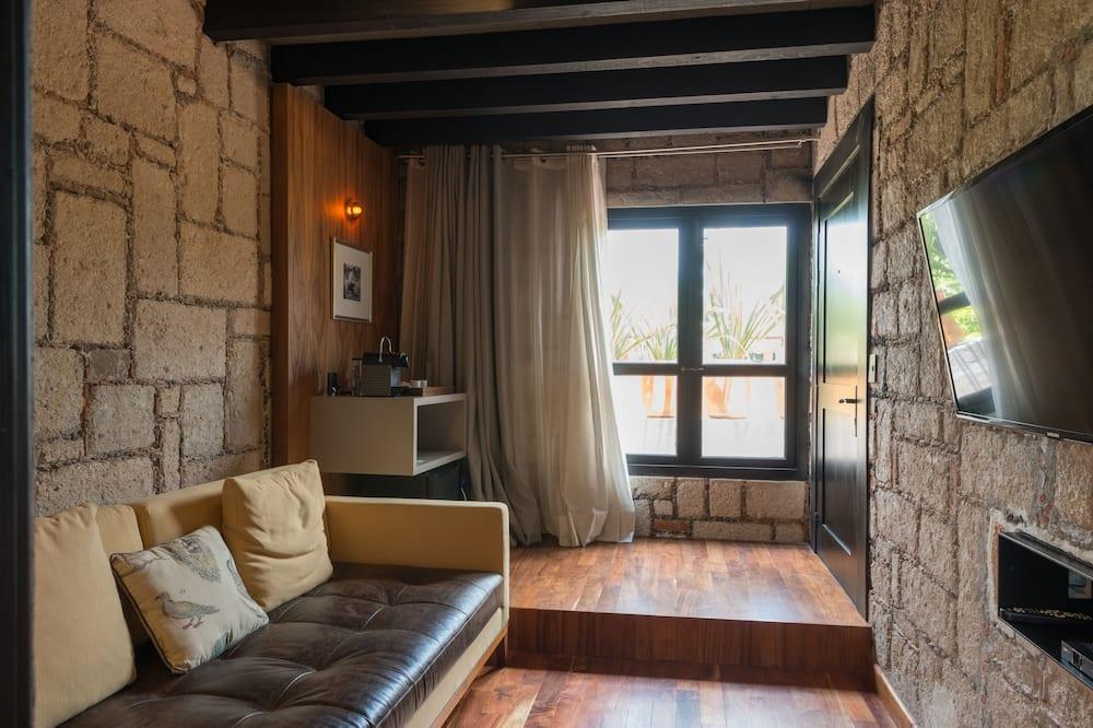 Suite, 1 letto king, vista città - Area soggiorno