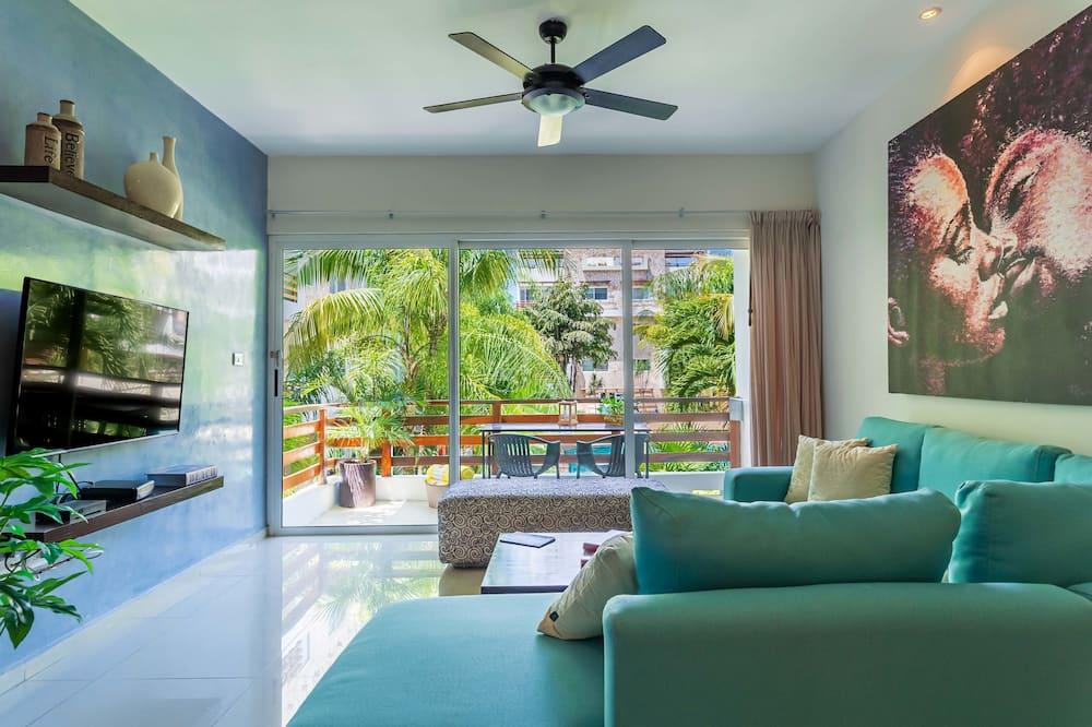 Deluxe appartement, 3 slaapkamers, kitchenette, aan tuin - Woonruimte