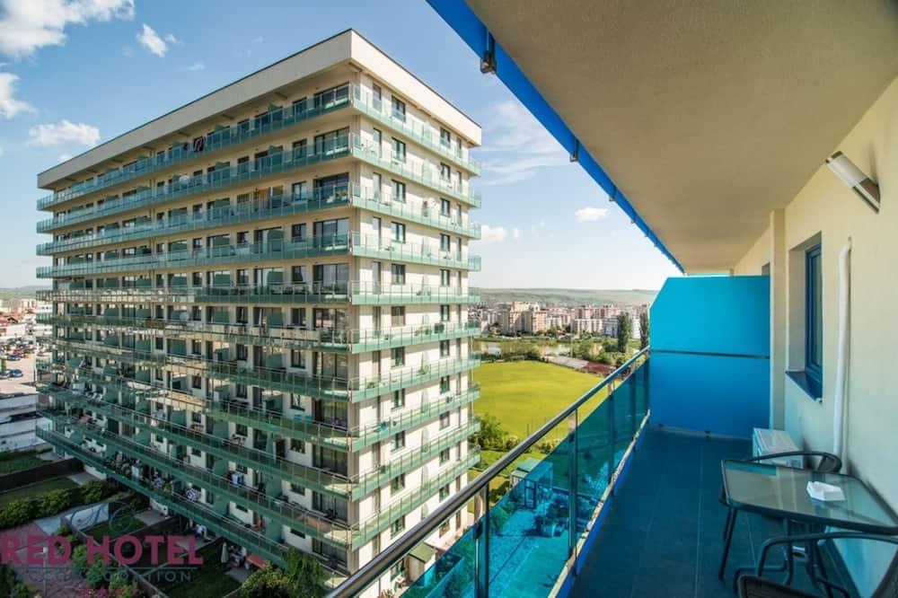 Paaugstināta komforta dzīvokļnumurs, 1 divguļamā karalienes gulta un dīvāngulta - Balkons