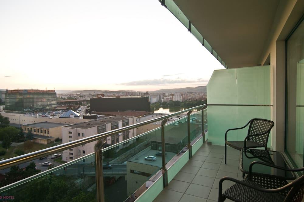 Dzīvokļnumurs ar papildu ērtībām, 1 divguļamā karalienes gulta - Balkons