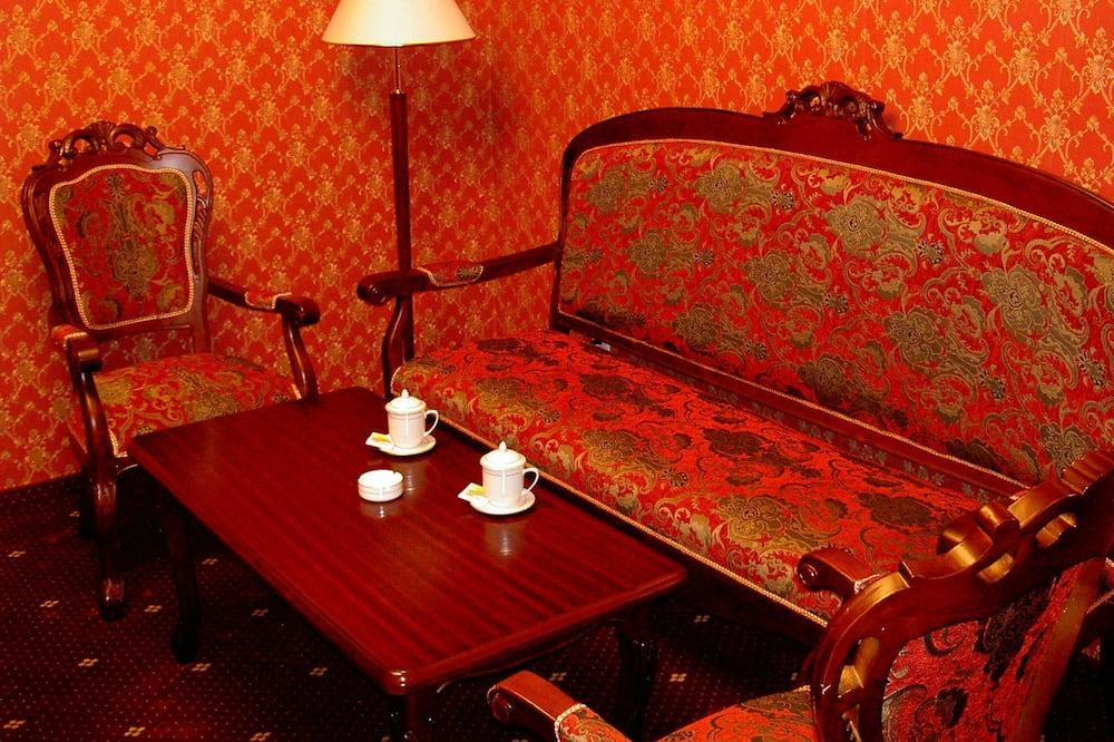 Familie tweepersoonskamer, 1 kingsize bed, Uitzicht op de stad - Woonkamer