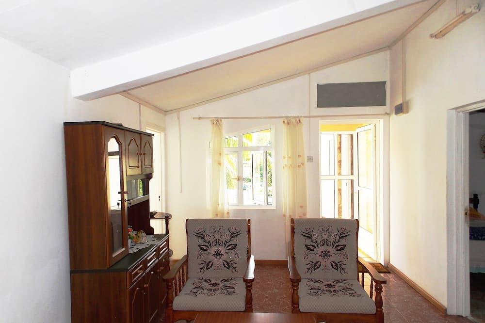 غرفة مزدوجة عادية - منظر للحديقة - غرفة معيشة