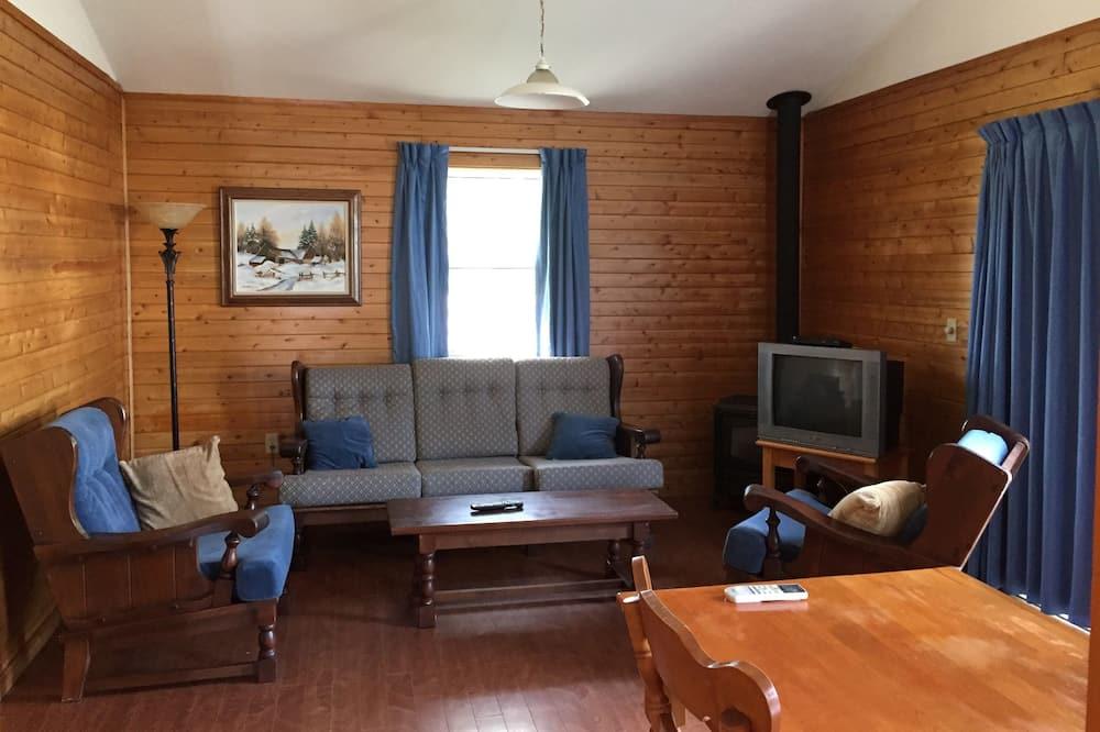 Rekreační domek, výhled do zahrady (1) - Obývací prostor