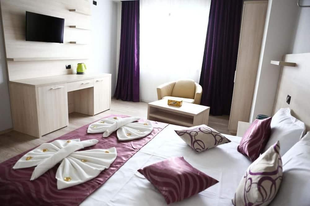 Семейный люкс, 1 двуспальная кровать с диваном-кроватью, вид на море - Номер