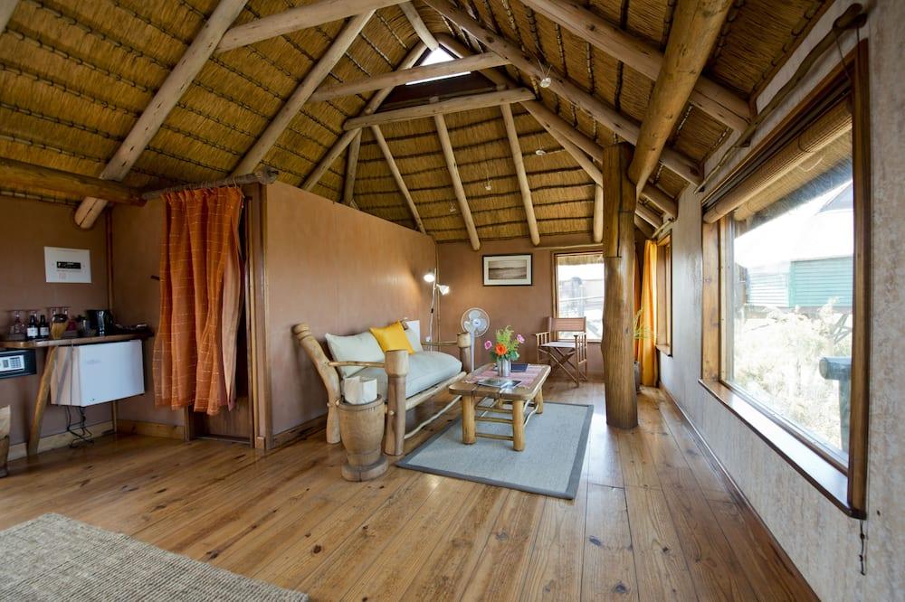 Бунгало, частичный вид на море - Зона гостиной