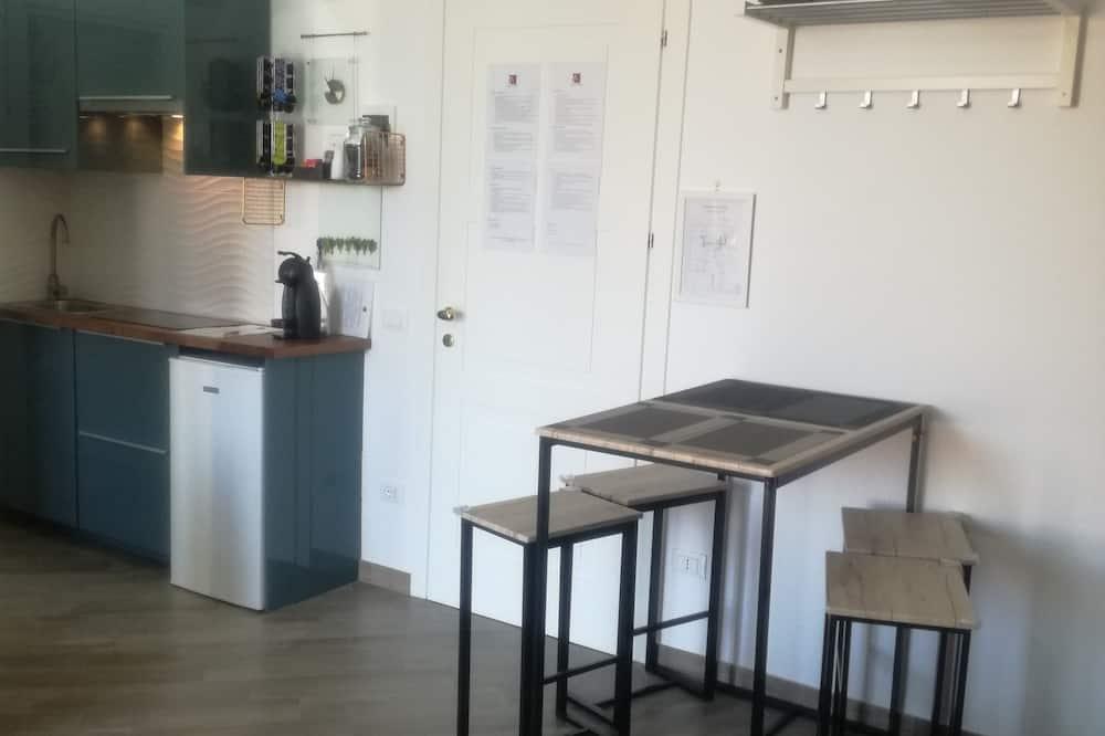 Deluxe Quadruple Room, 2 Bedrooms, Kitchenette - Living Area