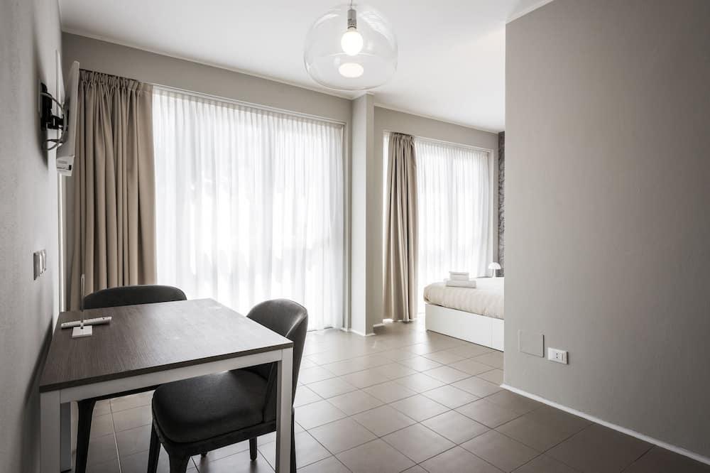 Studio Plus Gattamelata - Salle de séjour