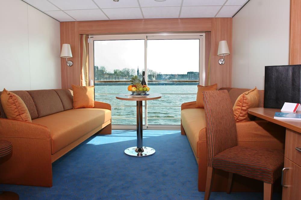 Klasikinio tipo dvivietis kambarys (2 viengulės lovos) - Svetainės zona