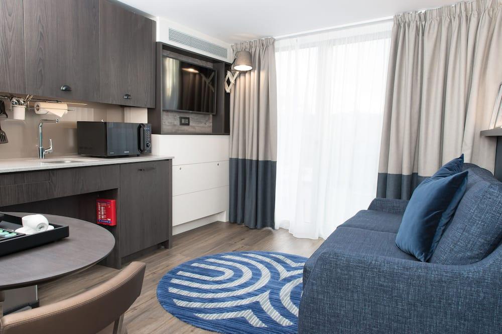 Štúdiový apartmán, 1 dvojlôžko, bezbariérová izba, nefajčiarska izba - Obývacie priestory