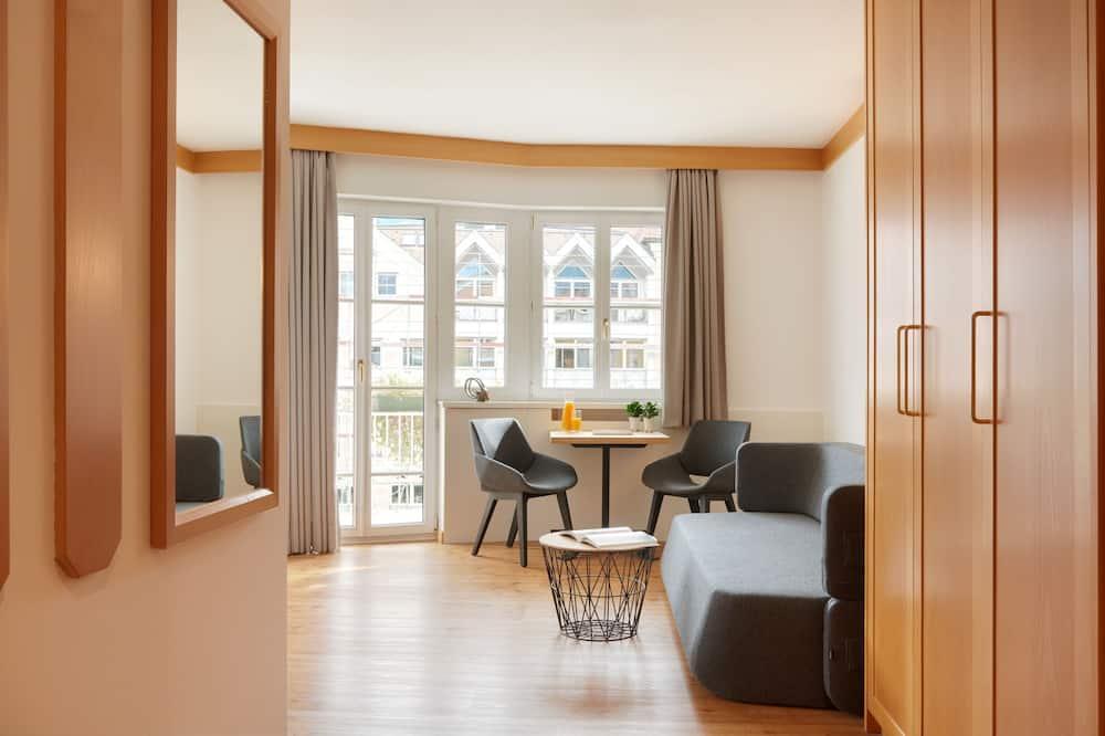 Улучшенный двухместный номер, одноместное размещение - Зона гостиной