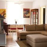 Chambre Quadruple, accessible aux personnes à mobilité réduite, non-fumeurs - Coin séjour